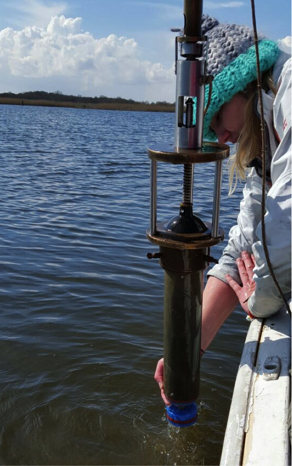 Lucy's project involves taking sediment cores from lakes.